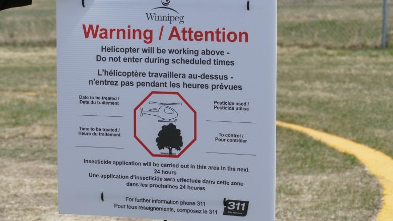 Look, overhead: New signs will warn of mosquito larvae-killing choppers