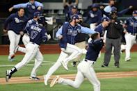 John Curtiss and Tampa Bay Rays teammates celebrate their 8-7 walkoff victory over the Los Angeles Dodgers that leveled the World Series at two games apiece
