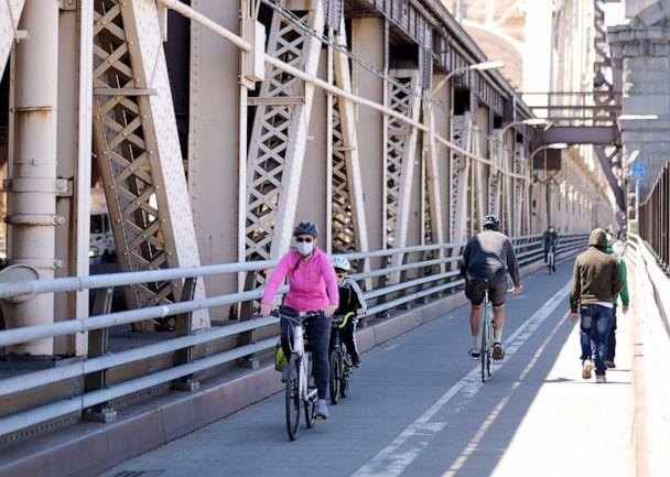 PHOTO: Cyclists ride on the Queensboro Bridge on May 13, 2020 in New York City. (Dimitrios Kambouris/Getty Images)