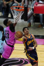Golden State Warriors guard Jordan Poole (3) aims for a basket as Miami Heat center Bam Adebayo (13) defends during the first half of an NBA basketball game, Thursday, April 1, 2021, in Miami. (AP Photo/Marta Lavandier)