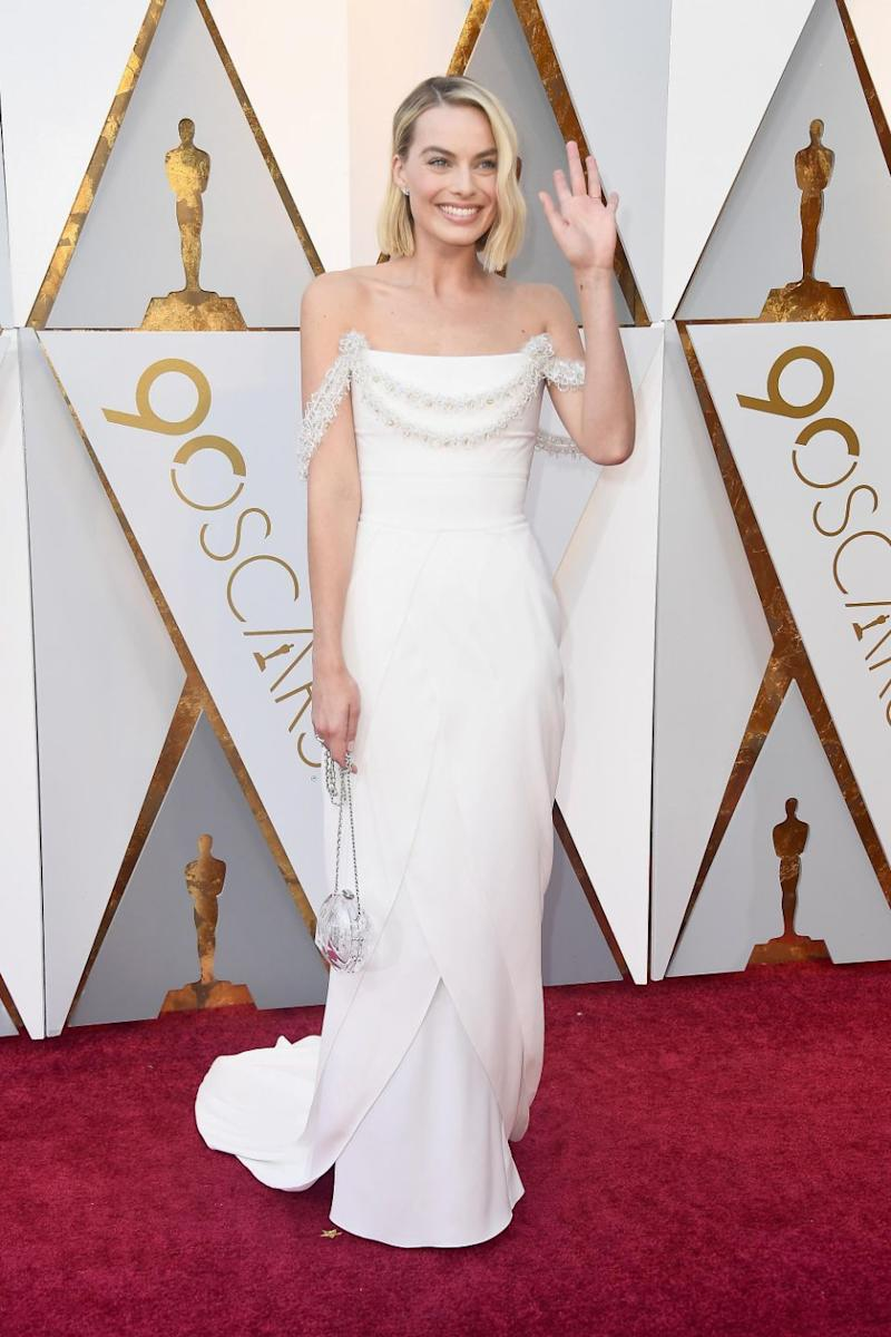 She waved to the crowd wearing a breathtaking white column Chanel dress. Photo: Getty Images