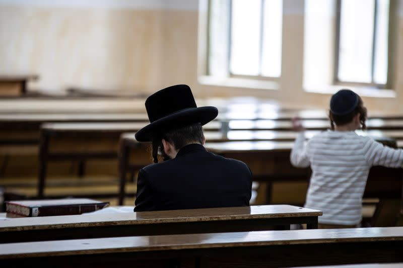 An Ultra Orthodox Jewish man sits in a religious study room in Jerusalem