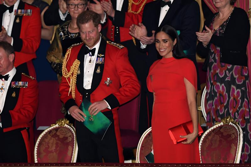 Britain's Prince Harry and his wife Meghan attend the Mountbatten Festival of Music at the Royal Albert Hall in London, Britain March 7, 2020. Eddie Mulholland/Pool via REUTERS