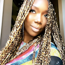 A nod to the early '00s, you can add some chunky highlights to your box braids to brighten things up.