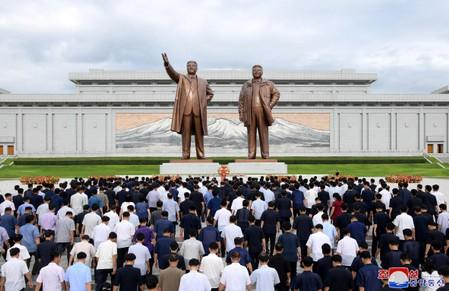 People visit the statues of former North Korean leaders Kim Il Sung and Kim Jong Il in North Korea