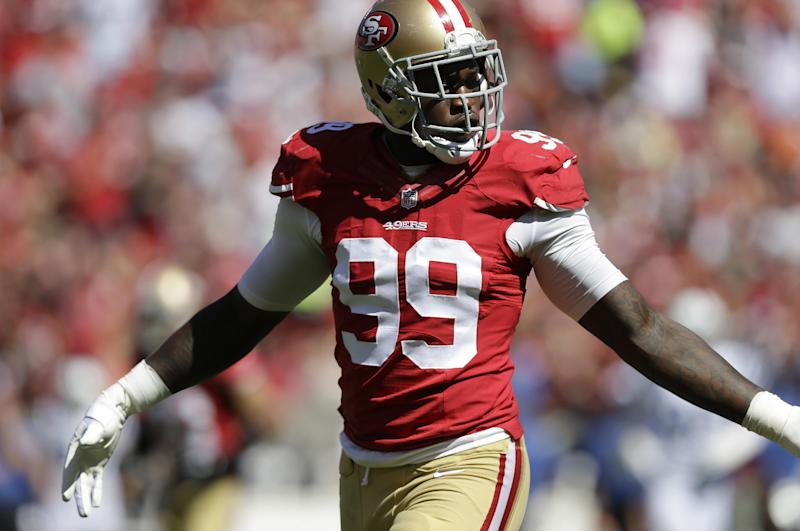 In this photo taken on Sept. 22, 2013, San Francisco 49ers linebacker Aldon Smith plays against the Indianapolis Colts during the first half of an NFL football game in San Francisco.  Smith has been activated to the roster on Thursday Oct. 31, 2013, from the non-football injury list, two days after he turned himself in to Santa Clara County authorities as he faces weapons charges