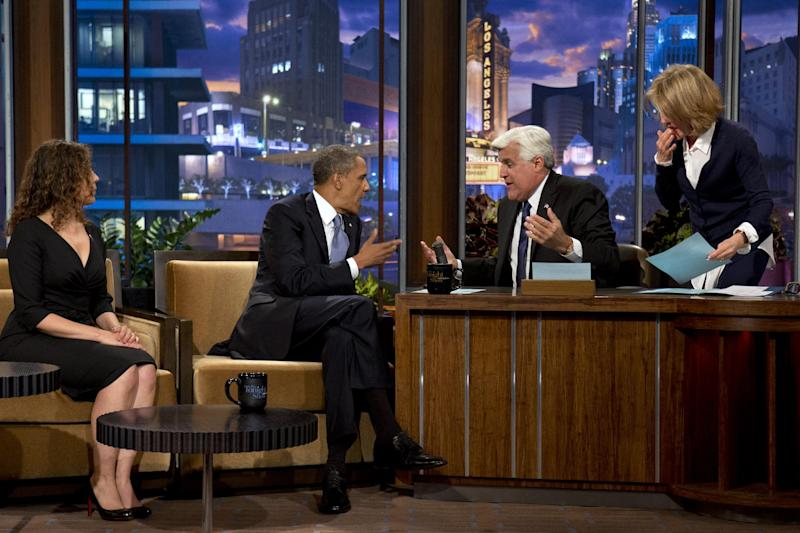 """President Barack Obama talks with Jay Leno during a commercial break during the taping of his appearance on """"The Tonight Show with Jay Leno"""" in Los Angeles, Tuesday, Aug. 6, 2013. (AP Photo/Jacquelyn Martin)"""