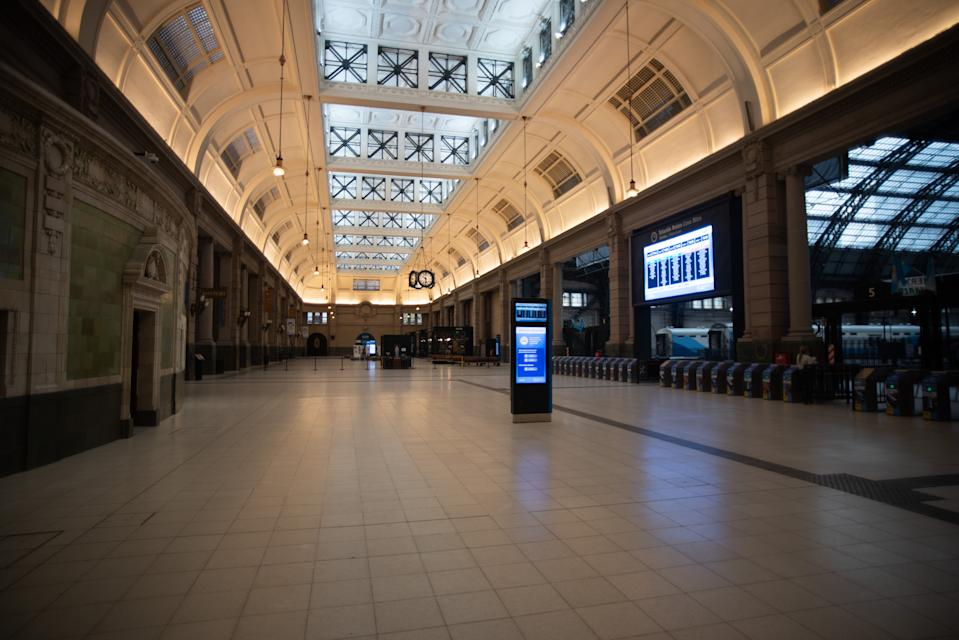 The empty hall of the  Retiro train Station, on April 1, 2020, in Buenos Aires, Argentina. The Argentine government extended the forced lock down to help contain the spread of the new coronavirus until easter (Photo by Mario De Fina/NurPhoto via Getty Images)