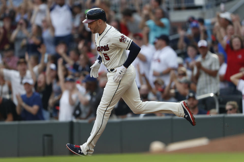 Atlanta Braves' Freddie Freeman rounds the bases after hitting a two-run home run in the first inning of a baseball game against the Chicago White Sox, Sunday, Sept. 1, 2019, in Atlanta. (AP Photo/John Bazemore)