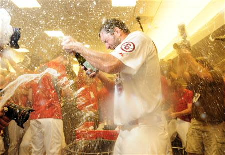 Oct 9, 2013; St. Louis, MO, USA; St. Louis Cardinals starting pitcher Adam Wainwright (50) celebrates with teammates after game five of the National League divisional series playoff baseball game against the Pittsburgh Pirates at Busch Stadium. Jeff Curry-USA TODAY Sports