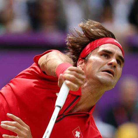 LONDON, ENGLAND - AUGUST 03: Roger Federer of Switzerland returns a shot to Juan Martin Del Potro of Argentina in the Semifinal of Men's Singles Tennis on Day 7 of the London 2012 Olympic Games at Wimbledon on August 3, 2012 in London, England. (Photo by Clive Brunskill/Getty Images)