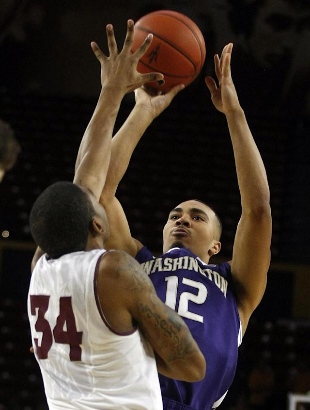 Washington guard Andrew Andrews (12) shoots over Arizona State guard Jermaine Marshall (34) during the first half of an NCAA basketball game on Thursday, Jan. 2, 2014, in Tempe, Ariz. (AP Photo/Rick Scuteri)