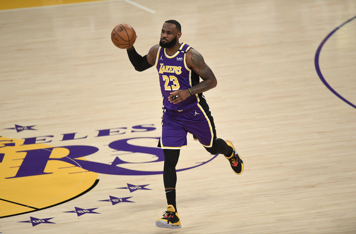 LOS ANGELES, CA - APRIL 30: LeBron James #23 of the Los Angeles Lakers dribbles the ball after returning to the starting lineup against the Sacramento Kings at Staples Center on April 30, 2021 in Los Angeles, California. NOTE TO USER: User expressly acknowledges and agrees that, by downloading and or using this photograph, User is consenting to the terms and conditions of the Getty Images License Agreement. (Photo by Kevork Djansezian/Getty Images)