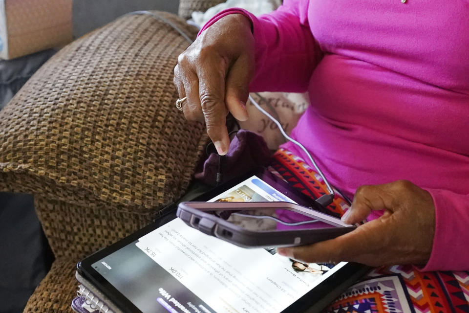 Mary Christian, 71, of McComb, Miss., recalls Friday, Jan. 15, 2021, the hours she spent on both her cell phone and iPad trying to arrange an appointment online for a COVID-19 vaccination through the Mississippi State Department of Health web site and on their listed registration phone line. Eventually, with help from one of her sons, she was able to enter the registration site only to find vaccination locations with openings were at least an hour's drive from the county she lives in and upon trying to sign up was informed they had no more openings. (AP Photo/Rogelio V. Solis)