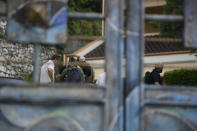 FBI agents assisting in the investigation over the assassination of Haiti´s President Jovenel Moise inspect his residence in Port-au-Prince, Haiti, Thursday, July 15, 2021. President Moise was assassinated at his home on July 7. (AP Photo/Matias Delacroix)