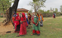 Women return to their village after attending an awareness program on getting tested and vaccinated against COVID-19 in Jamsoti village, Uttar Pradesh state, India, on June 10, 2021. India's vaccination efforts are being undermined by widespread hesitancy and fear of the jabs, fueled by misinformation and mistrust. That's especially true in rural India, where two-thirds of the country's nearly 1.4 billion people live. (AP Photo/Rajesh Kumar Singh)