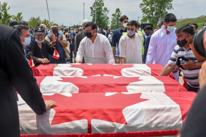 FILE PHOTO: People transport three flag-wrapped coffins at the funeral of the Afzaal family that was killed in London
