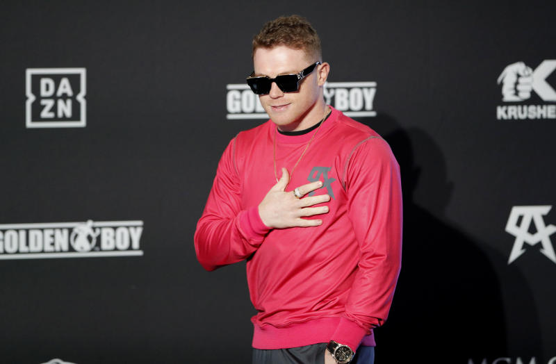 Canelo Alvarez motions to the crowd during a ceremonial arrival for an upcoming boxing match Tuesday, Oct. 29, 2019, in Las Vegas. Alvarez is scheduled to fight Sergey Kovalev in a WBO light heavyweight title bout Saturday in Las Vegas. (AP Photo/John Locher)