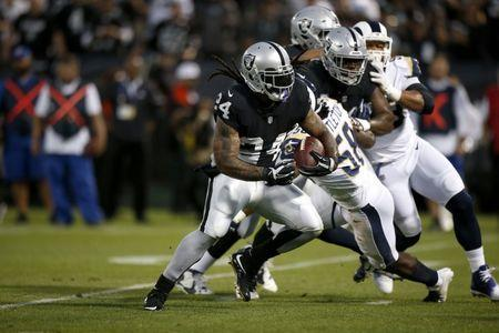 Sep 10, 2018; Oakland, CA, USA; Oakland Raiders running back Marshawn Lynch (24) runs for a touchdown against the Los Angeles Rams in the first quarter at Oakland Coliseum. Mandatory Credit: Cary Edmondson-USA TODAY Sports