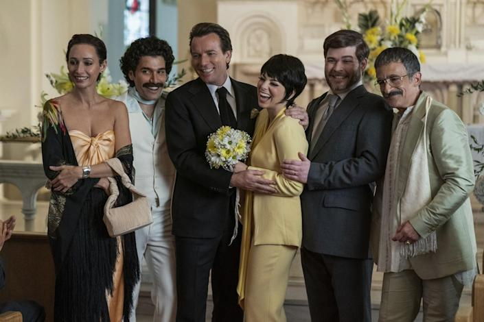 """A scene from """"Halston"""" shows Liza Minnelli and her wedding party smiling and laughing in the 1970s."""
