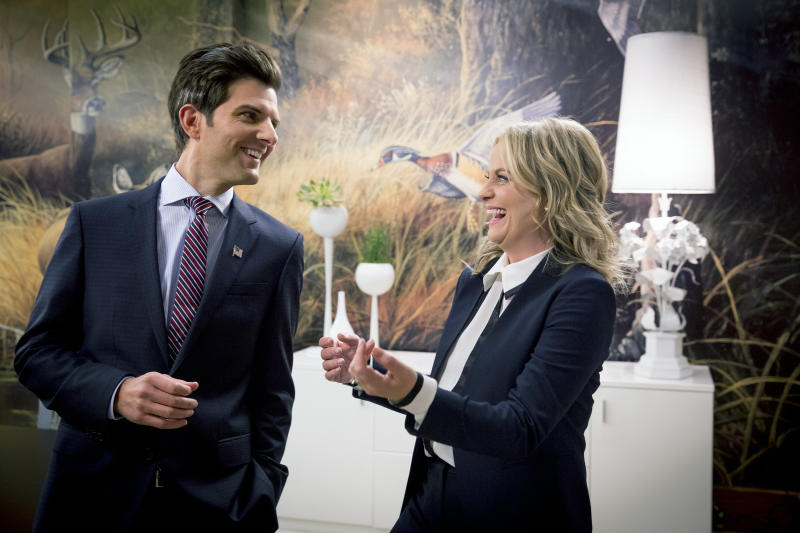 "PARKS AND RECREATION -- ""One Last Ride"" Episode 712/713 -- Pictured: (l-r) Adam Scott as Ben Wyatt, Amy Poehler as Leslie Knope -- (Photo by: Paul Drinkwater/NBCU Photo Bank/NBCUniversal via Getty Images via Getty Images)"