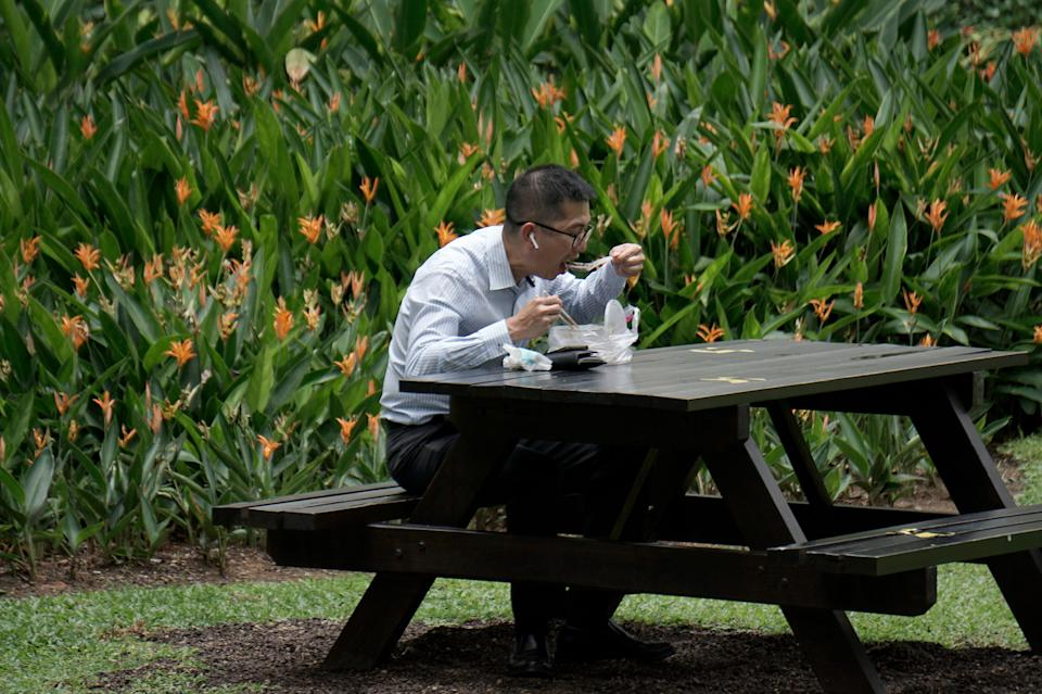 A man seen having his lunch at the Telok Ayer Park on 7 April 2020, the first day of Singapore's month-long circuit breaker period. (PHOTO: Dhany Osman / Yahoo News Singapore)