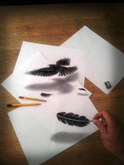 """<b>Feather of a raven:</b> """"Airbrushing is a great technique for making paintings with depth and realism,"""" Bruin told the <a href=""""http://www.nydailynews.com/entertainment/music-arts/pencil-paper-artist-works-3-d-article-1.1186885"""" rel=""""nofollow noopener"""" target=""""_blank"""" data-ylk=""""slk:New York Daily News"""" class=""""link rapid-noclick-resp"""">New York Daily News</a>. <br> <br> <a href=""""http://www.jjkairbrush.nl/home/"""" rel=""""nofollow noopener"""" target=""""_blank"""" data-ylk=""""slk:(Courtesy of Ramon Bruin)"""" class=""""link rapid-noclick-resp"""">(Courtesy of Ramon Bruin)</a>"""