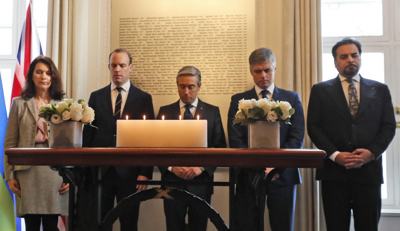 Francois-Philippe Champagne, Canada Minister of Foreign Affairs, centre, Ukraine Minister of Foreign Affairs Vadym Prystaiko, second right, United Kingdoms Secretary of State for Foreign Affairs Dominic Raab, second left, Sweden's Minister of Foreign Affairs Ann Linde, left, and Afghanistan's Foreign Minister Idrees Zaman, hold a minute of silence behind candles and in front of a plaque with the names of the victims of flight PS752, at the High Commission of Canada in London, Thursday, Jan. 16, 2020. The Foreign ministers gather in a meeting of the International Coordination and Response Group for the families of the victims of PS752 flight crashed shortly after taking off from the Iranian capital Tehran on Jan. 8, killing all 176 passengers and crew on board.(AP Photo/Frank Augstein)