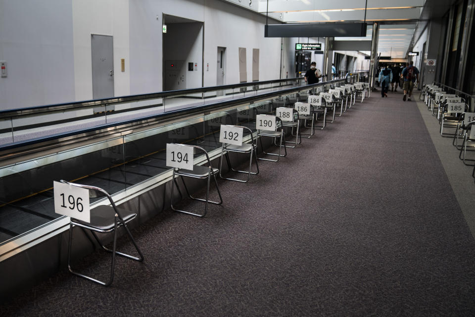 Chairs are numbered in the holding area for foreign visitors at the Narita International Airport on July 10, 2021, in Narita, near Tokyo. Japan's massive security apparatus for the upcoming Summer Olympics is raising complaints that the nation, during the weeks of the Games, will look more like authoritarian North Korea or China than one of the world's most powerful, vibrant democracies. (AP Photo/Jae C. Hong)