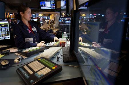 Trader Amanda Anderson works on the floor of the New York Stock Exchange after the opening bell in New York, December 24, 2013. REUTERS/Carlo Allegri