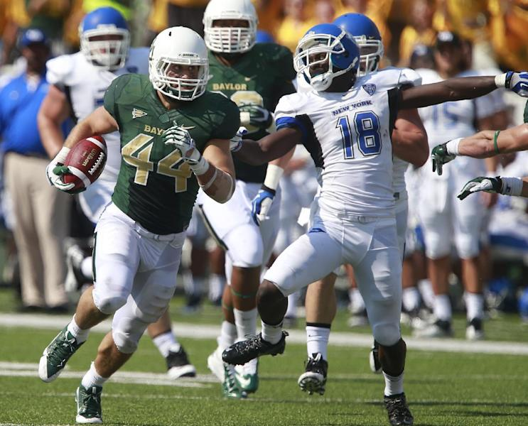 Baylor linebacker Bryce Hager (44) scores past Buffalo wide receiver Fred Lee (18) on a fumble return in the first half of a NCAA college football game, Saturday, Sept., 7, 2013, in Waco, Texas. (AP Photo/Waco Tribune Herald, Jose Yau)