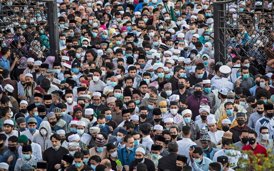 Muslim worshippers arrive to attend Eid al-Fitr prayer, which marks the end of the holy fasting month of Ramadan - Khaled Desouki