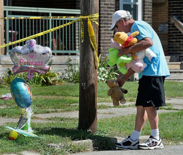 PHOTO: Paul Laughlin, 57, places stuffed animals outside a home at 1248 West 11th St. in Erie, Pa., where multiple people died in an early-morning fire, Aug. 11, 2019. (Greg Wohlford/Erie Times-News via AP)