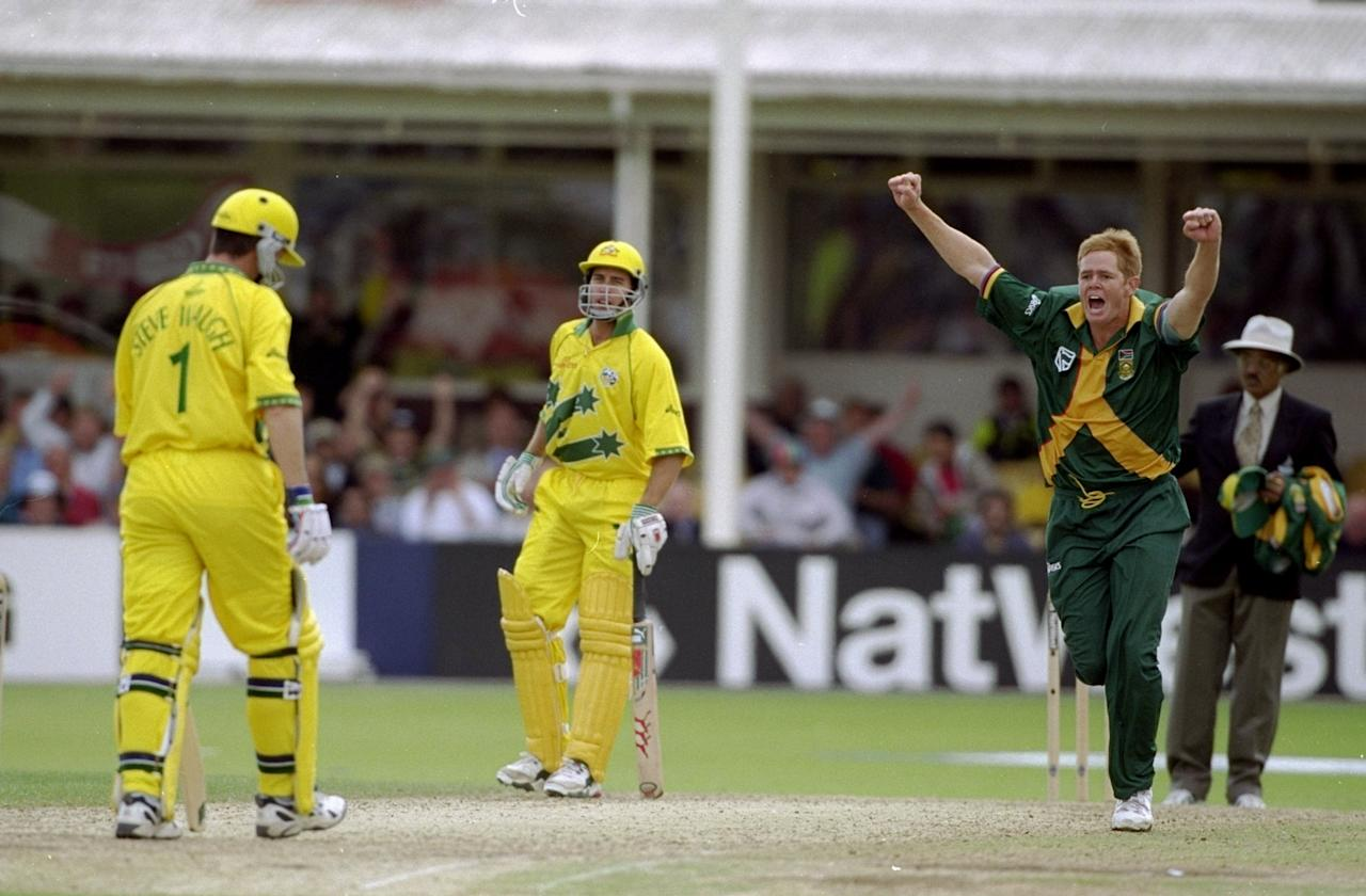 17 Jun 1999:  Shaun Pollock of South Africa takes the wicket of Steve Waugh of Australia in the World Cup semi-final at Edgbaston in Birmingham, England. The match finished a tie as Australia went through after finishing higher in the Super Six table. \ Mandatory Credit: Craig Prentis /Allsport
