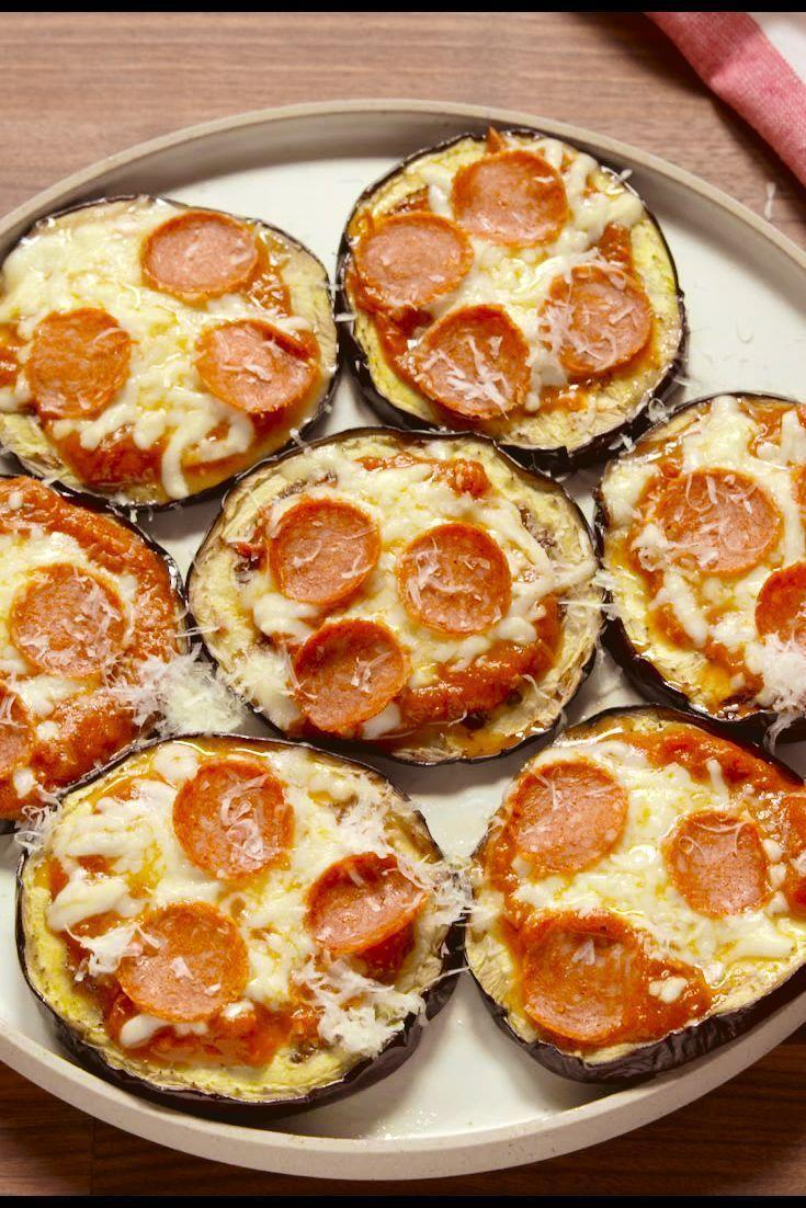 """<p>With pizza on a veggie, you can have pizza anytime!</p><p>Get the <a href=""""https://www.delish.com/uk/cooking/recipes/a28960291/eggplant-pizza-bites-recipe/"""" rel=""""nofollow noopener"""" target=""""_blank"""" data-ylk=""""slk:Aubergine Pizza Bites"""" class=""""link rapid-noclick-resp"""">Aubergine Pizza Bites</a> recipe.</p>"""