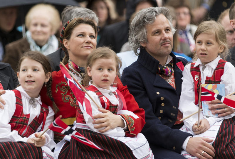 A photo of Princess Martha Louise, Ari Behn, Maud Angelica, Leah Isadora and Emma Tallulah wearing national dress in Southwark Park as they celebrate Norway National Day on May 17, 2013 in London, England.