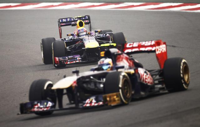 Toro Rosso Formula One driver Daniel Ricciardo of Australia (front) drives ahead of Red Bull Formula One driver Mark Webber of Australia during the second practice session of the Indian F1 Grand Prix at the Buddh International Circuit in Greater Noida, on the outskirts of New Delhi, October 25, 2013. REUTERS/Anindito Mukherjee (INDIA - Tags: SPORT MOTORSPORT F1)