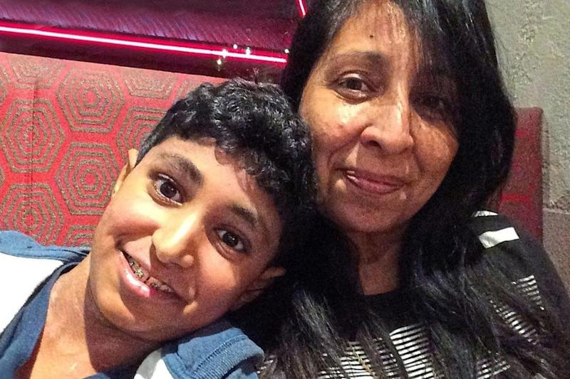 Karanbir Cheema with mother Rina. An inquest heard paramedics treated him at school in Greenford