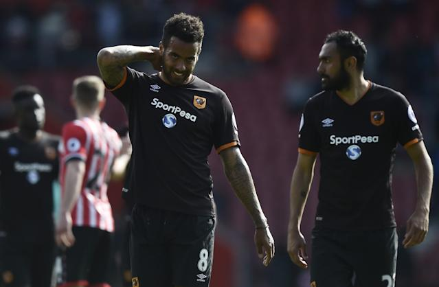 <p>Hull City's Tom Huddlestone and Ahmed Elmohamady at full time </p>