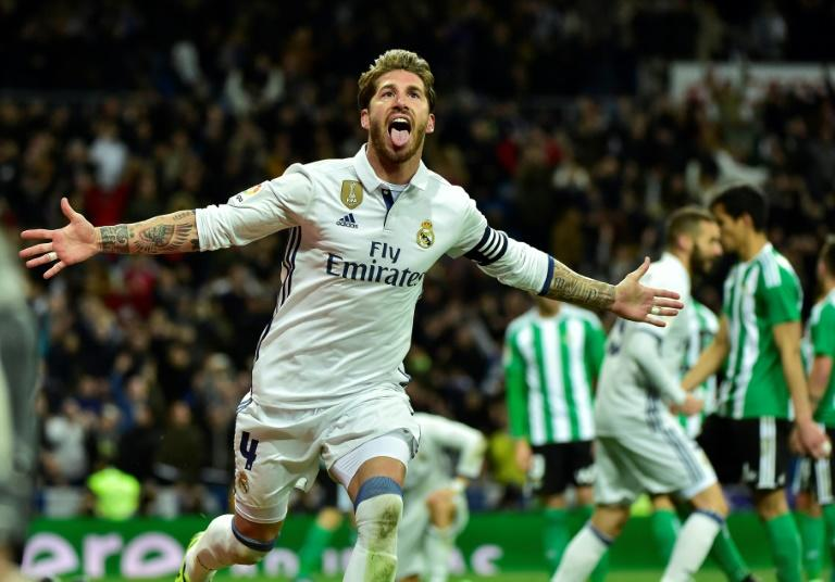 Real Madrid's defender Sergio Ramos celebrates after scoring a goal during the Spanish league footbal match Real Madrid CF vs Real Betis at the Santiago Bernabeu stadium in Madrid on March 12, 2017