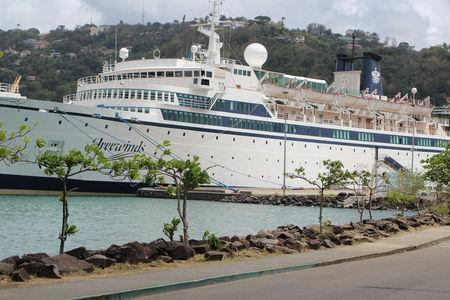 A 440-foot ship owned and operated by the Church of Scientology, SMV Freewinds, is docked under quarantine from a measles outbreak in port near Castries, St. Lucia, May 2, 2019.  REUTERS/Micah George