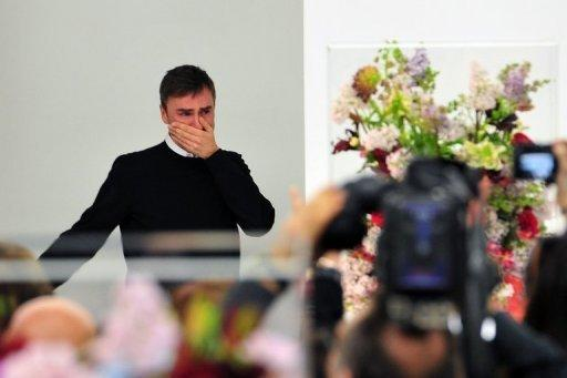 Belgian designer Raf Simons cries at the end of the Jil Sander Fall-winter 2012-2013 collection