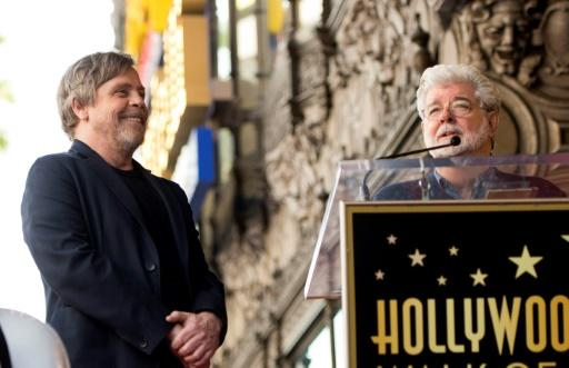 "Actor Mark Hamill (L) -- shown here with ""Star Wars"" director George Lucas as Hamill received a star on the Hollywood Walk of Fame in March 2018 -- has leapt to the defense of his co-stars"