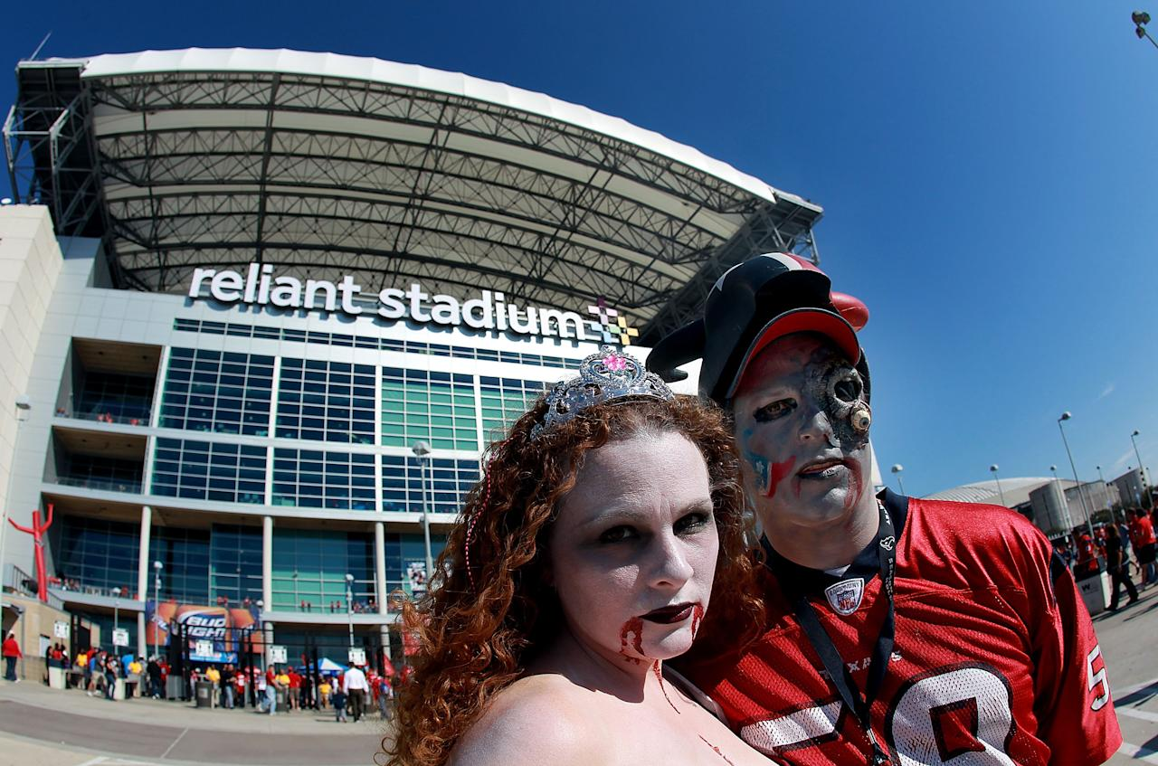 HOUSTON, TX - OCTOBER 30:  NFL fans, (L-R) Amy and Donnie Eason dress for Halloween before a game between the Jacksonville Jaguars and the Houston Texans at Reliant Stadium on October 30, 2011 in Houston, Texas.  (Photo by Ronald Martinez/Getty Images)