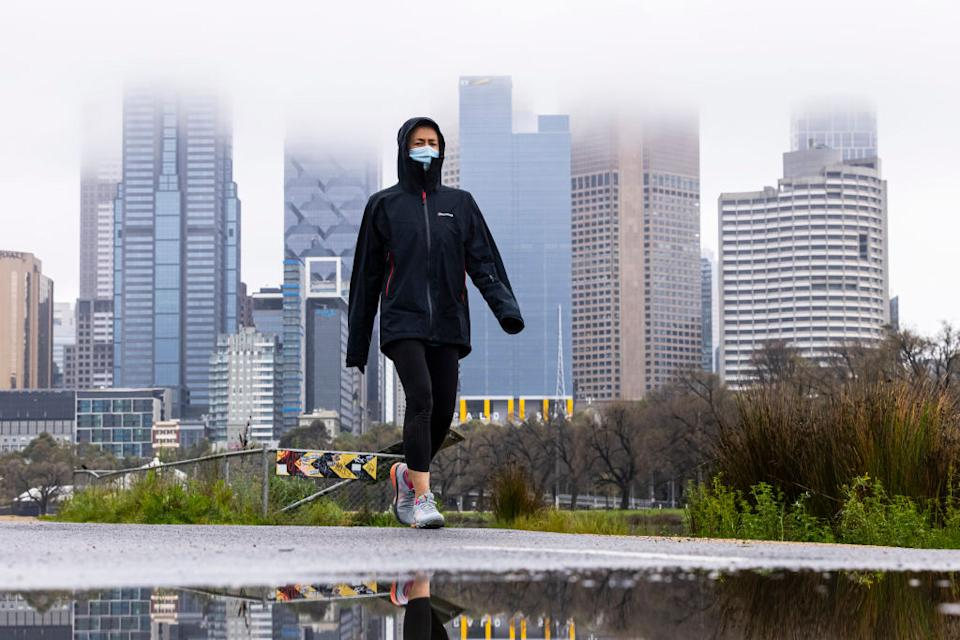 A lone person is seen exercising along the Yarra River in Melbourne, Australia.