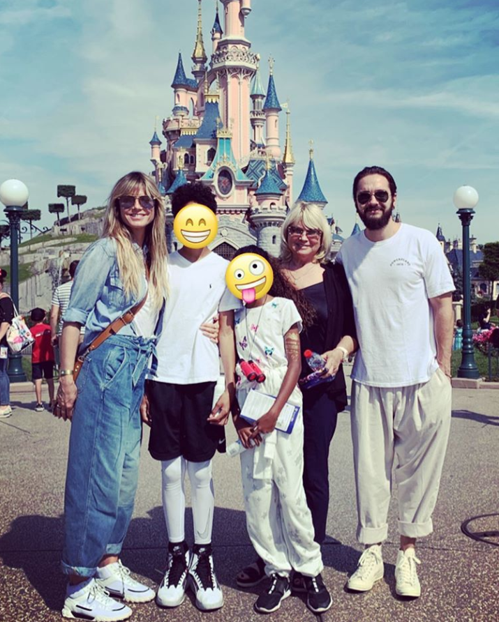 "The supermodel shared a photo from her trip to Disneyland Paris, which she says is the ""the happiest place on earth,"" with her fiancé Tom Kaulitz and her children, whose faces she covered with smiling emojis."