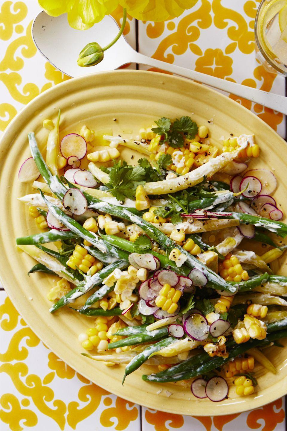 "<p>Make your own dressing for this bean and corn salad with just four ingredients.<br></p><p><em><a href=""https://www.womansday.com/food-recipes/food-drinks/a22064579/summer-bean-corn-and-radish-salad-recipe/"" rel=""nofollow noopener"" target=""_blank"" data-ylk=""slk:Get the recipe for Summer Bean, Corn, and Radish Salad."" class=""link rapid-noclick-resp"">Get the recipe for Summer Bean, Corn, and Radish Salad.</a></em></p>"