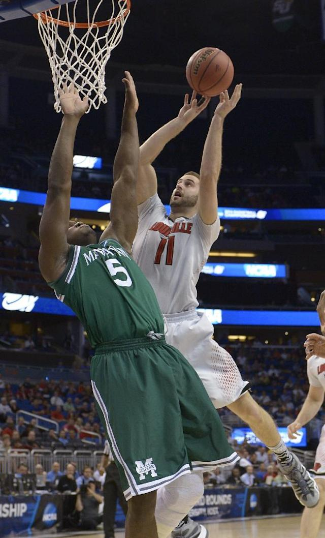 Louisville forward Luke Hancock (11) drives to the basket as Manhattan center Rhamel Brown (5) defends in a second-round game in the NCAA college basketball tournament Thursday, March 20, 2014, in Orlando, Fla. (AP Photo/Phelan M. Ebenhack)