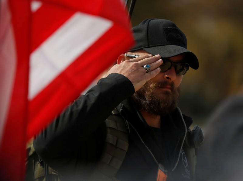"""A pro-gun rights activist participating in the """"Declaration of Restoration"""" salutes in Washington, D.C."""