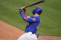 New York Mets' Pete Alonso hits a grand slam during the fifth inning of a spring training baseball game against the Washington Nationals, Thursday, March 4, 2021, in Port St. Lucie, Fla. (AP Photo/Lynne Sladky)